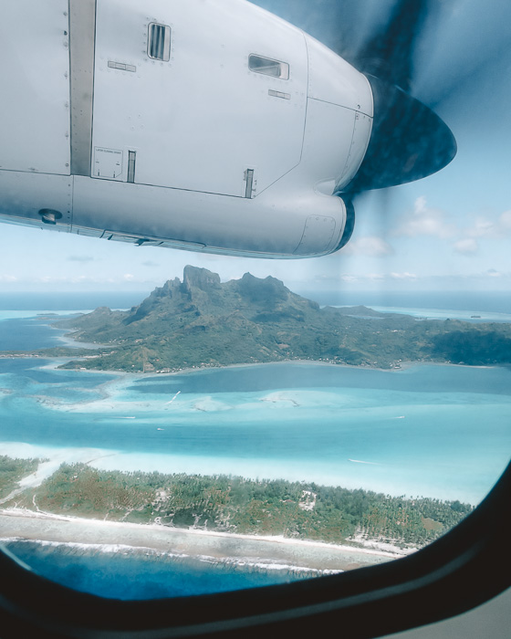French Polynesia travel guide view over Bora-Bora from the plane by Dancing the Earth