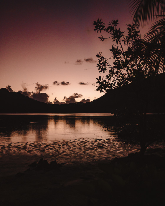 French Polynesia travel log Red sun over Huahine lagoon from Pension Tupuna by Dancing the Earth