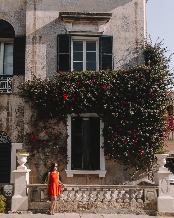Old house with blue windows and flowers in Mdina by Dancing the Earth