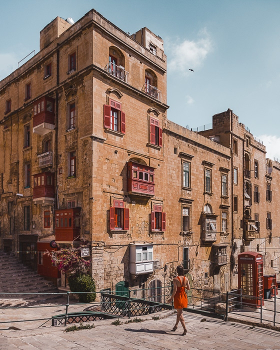 Malta travel guide Valletta red balconies by Dancing the Earth