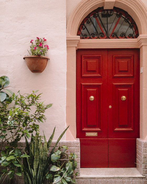 Vittoriosa red door by Dancing the Earth