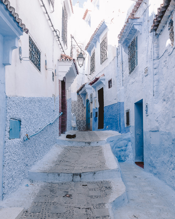 Morocco travel guide Chefchaouen light-blue winding stairs by Dancing the Earth
