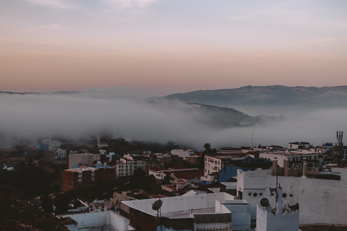 Morocco travel guide Chefchaouen inverted clouds at sunrise by Dancing the Earth