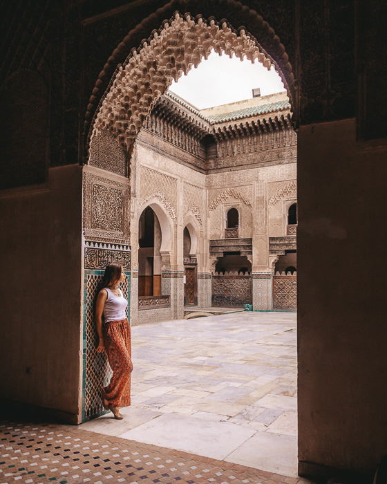 Morocco travel guide Fes Bou Inania Medersa framed by door by Dancing the Earth