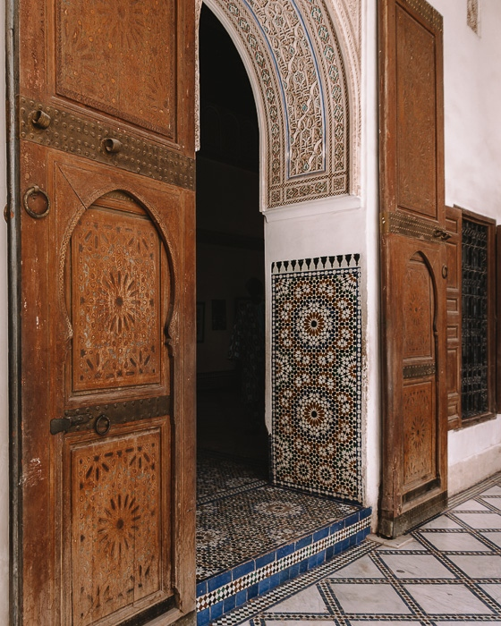 Morocco travel guide Bahia Palace carved wood door with tiles by Dancing the Earth