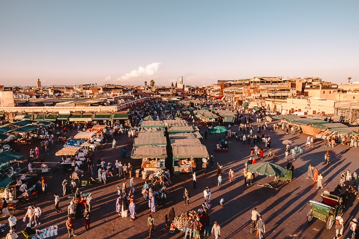 Morocco travel guide Place Jemaa el Fnaa in Marrakesh at sunset by Dancing the Earth