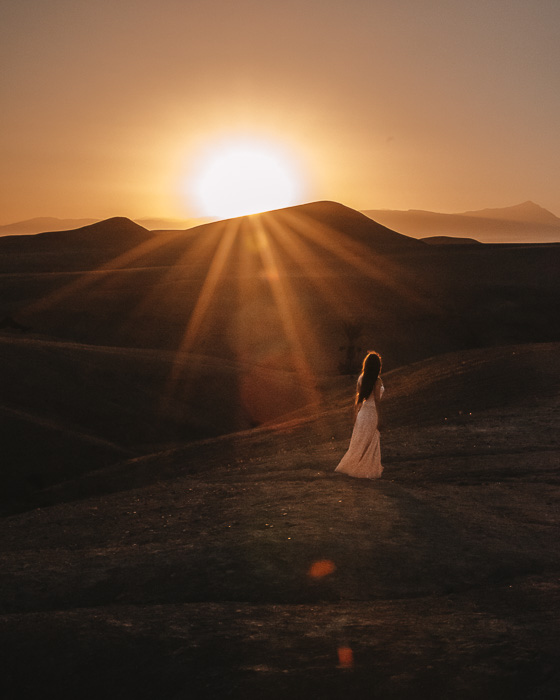 Morocco travel guide sun rising over the desert from Scarabeo Camp by Dancing the Earth