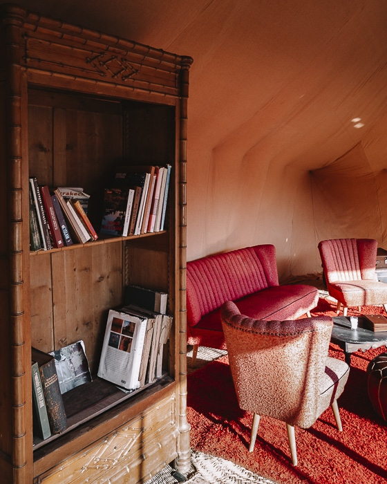 Bookshelves in the living room tent of Scarabeo Camp by Dancing the Earth