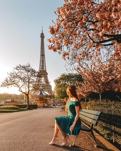 Spring in Paris sitting under the cherry blossoms in front of Eiffel Tower by Dancing the Earth