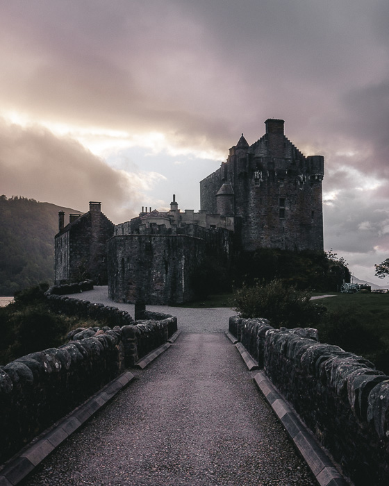 Scotland travel itinerary sunset at Eilean Donan Castle by Dancing the Earth