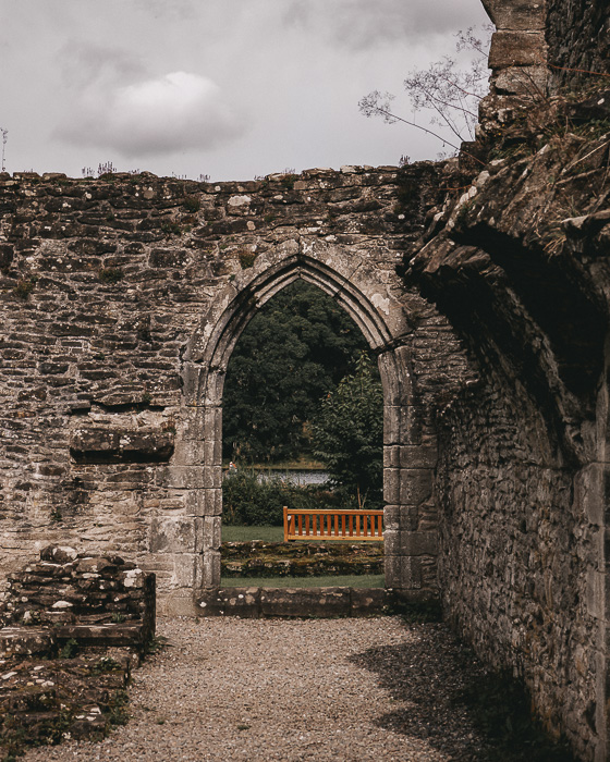 Scotland travel itinerary Inchmahome Priory door and bench by Dancing the Earth
