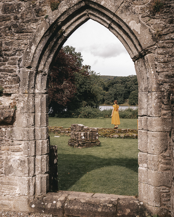 Scotland travel itinerary Inchmahome Priory framed by door by Dancing the Earth