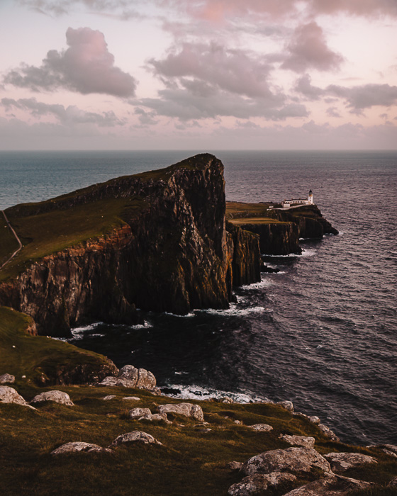 Scotland travel itinerary Isle of Skye sunset at Neist Point Lighthouse by Dancing the Earth