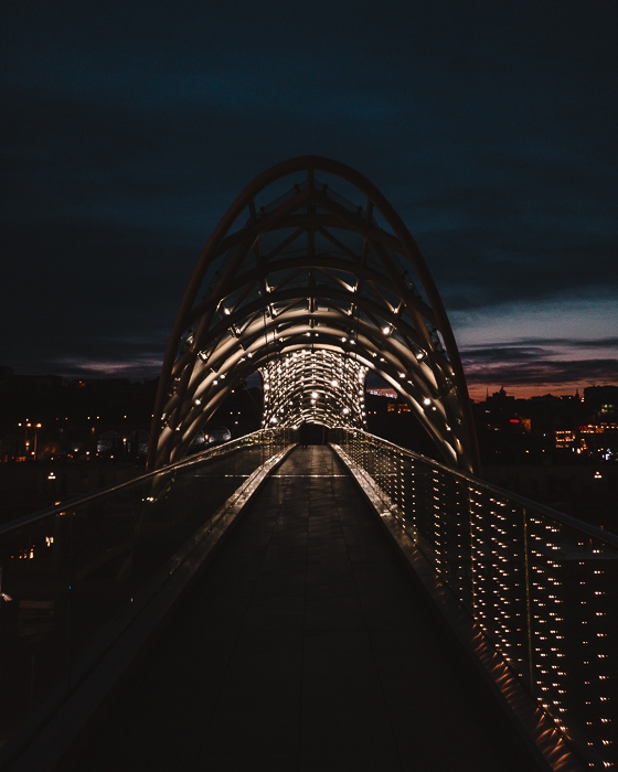 Tbilisi Peace Bridge by night by Dancing the Earth