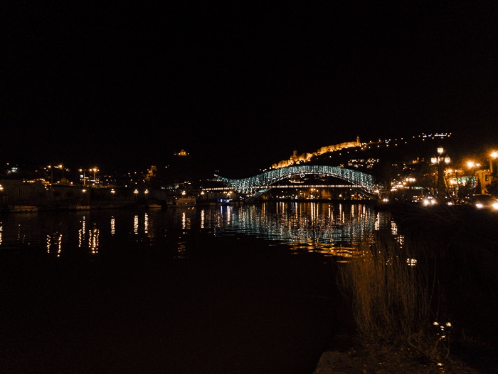 Tbilisi Peace Bridge from the distance by night by Dancing the Earth