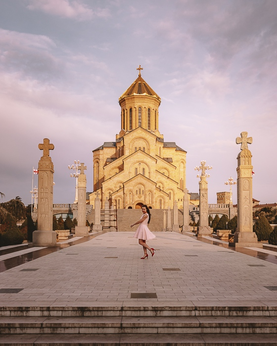 Tbilisi sunset at Sameba Cathedral by Dancing the Earth