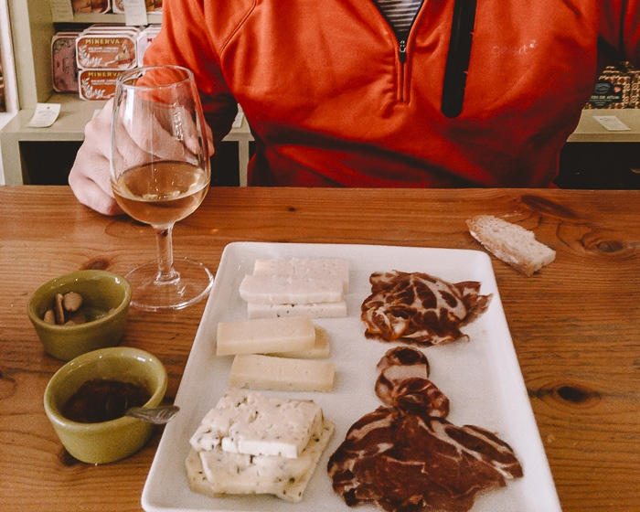 cheese and meat board at Mercearia das Flores by Dancing the Earth